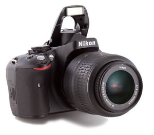 Nikon D5100 with 18-55mm lens, battery, charger, strap