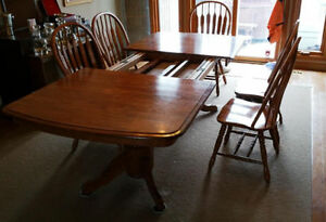 Solid oak dining table with built-in extension and 8 chairs