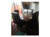 Large solid dinning table and 6 high back chairs