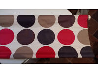 Red/brown dotted black-out roller blind