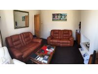 Two tan brown leather electric recliner sofas