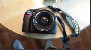 Camera NIKON D40 avec objectif AF NIKKOR 28-70mm et un de 200mm