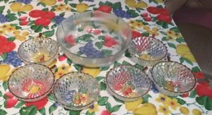 glass serving bowl and 6 gold coloured rimmed glass desert bow
