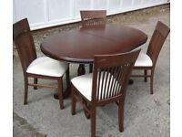 Nice dark wood pedestal legged extending table and 4 highback chairs