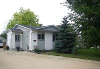 Quiet country living, minutes from the city in desirable Lorette