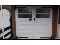 Original wooden garage doors with iron hinges, handle and locks. Excellent condition