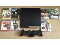 PS3 with 7 Games and 2 controllers