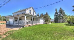 8 bedroom home in quiet town of Nobleford-613 Highway Ave