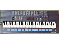 Yamaha PSS-680 FM keyboard. Boxed with power supply and instruction manual