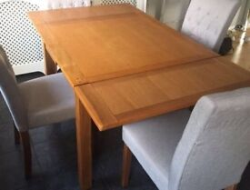 Solid oak extendable table and 4 chairs