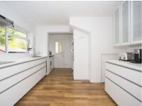 Modern White Kitchen with Induction Hob, Extractor, Sink & Tap