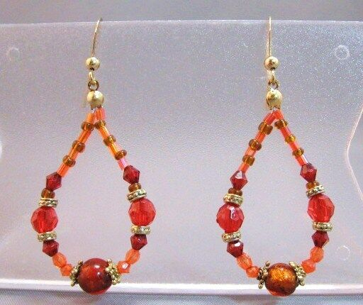 Shades of red and orange beads dangle hanging earrings