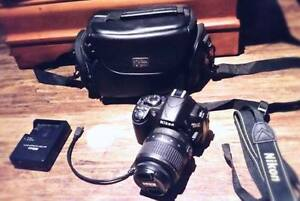 NIKON DSLR CAMERA WITH LENS AND CARRY CASE
