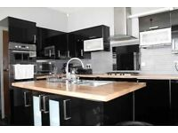 Large used black gloss kitchen for sale