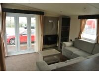 Stylish swift 2 bedroom caravan integrated kitchen gch,dbl glazing near the sea and new decking