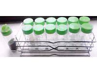 Rectangular Wireware Chrome Look Spice Rack with 13 Green Lidded Glass Jars Set.