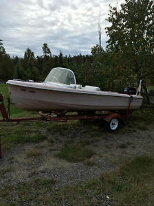 1960 Larson boat with 1995 25 hp Evinrude and trailer