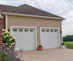 White garage doors for sale. Brand new!