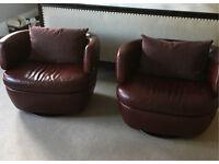 Natuzzi leather swivel armchairs