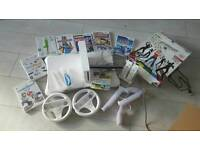 Wii bundle, fit board, dance mat, games, charging station 2 wheels and guns