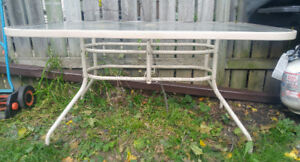 Steel and glass dinning patio table