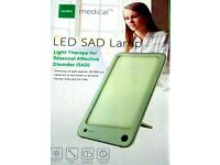 NEW PORTABLE THERAPY LIGHT LESS THAN HALF PRICE.