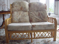 Cane settee and 2 matching Armchairs with cushions