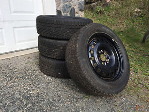 Set of 4 winter tires on black steel rims