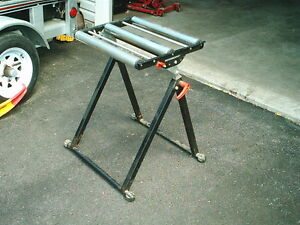 Carpenters - buy this roller stand to support wood from your saw