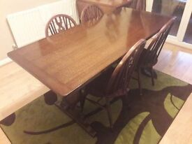 Beautiful solid oak Priory old charm table & 4 solid oak Wheelback chairs. Lovely piece of furniture