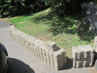 Grey interlocking bricks/paving stones
