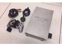 Rare silver PlayStation 2 games and memory card