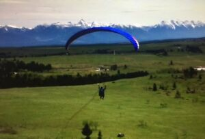 Like new paraglider and harness for sale