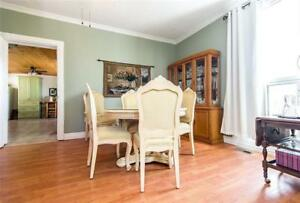 Cream Dining room table and 5 Chairs