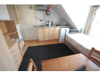 Single bedsit with own kitchenette and shared shower room. For 1 person only.