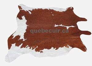 COWHIDE RUG BROWN AND WHITE. TAPIS EN PEAU DE VACHE. IMPORTATEUR