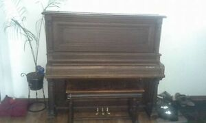 Grinnell Bros. Upright Concert Grand piano