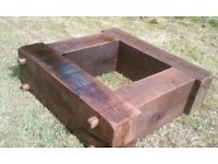 Solid oak beam planter with hand hewn pegs
