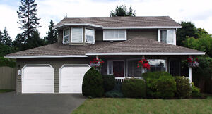 Gorgeous 2 Storey Ground Level Entry Home in Comox