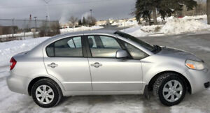 2011 Suzuki SX4 Sedan w/ only 71,000 Kms & Clean Active Status