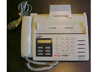 Fax machine with fax rolls