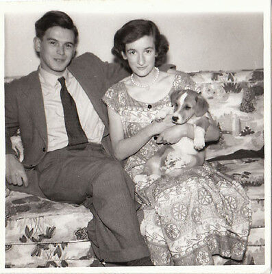 Vintage photo young couple n love w Corgi puppy dog on flowered couch