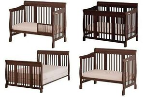 Stork 4 in 1 convertible crib with cherry wood finish