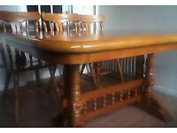 Solid wood table great condition, six matching chairs