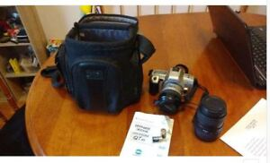 Minolta camera with extra lens ( worth 300.00 alone) and camera