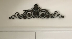 Two bronze/black wrought metal wall sconces