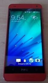 HTC ONE MOBILE PHONE CRACKED SCREEN BUT TOTALLY USE ABLE. SEE PHOTOS.