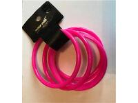 Neon pink bangles