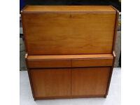Retro 1970's bureau in a medium coloured wood with a key