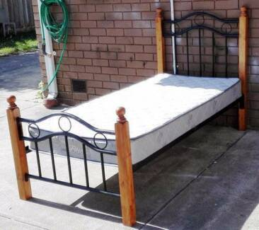 king single wooden and metal frame bed with mattress
